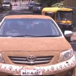 Cow-dung coated Toyota Corolla Altis