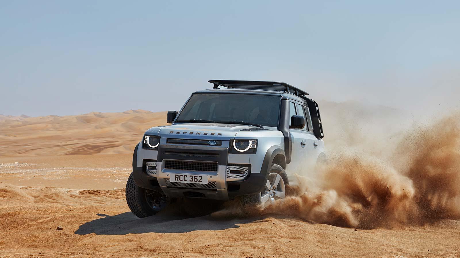 Land Rover Defender Suv On Dirt